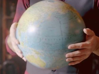 World map in the hands of a person